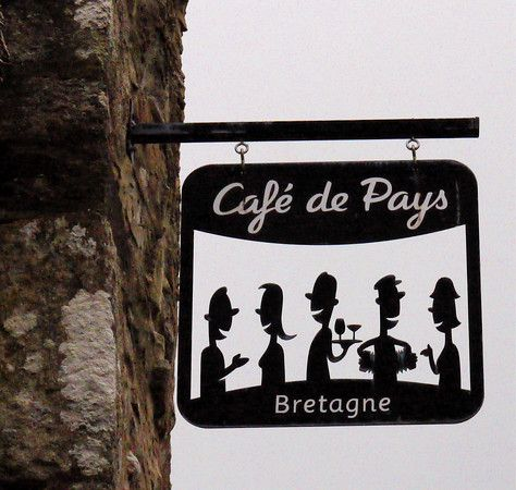 From a cafe in Moncontour, Brittany, France.  Like the blade sign style and the die-cut metal.