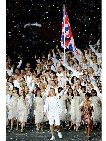 Sir Chris Hoy of the Great Britain Olympic cycling team carries his country's flag as he leads Great Britain into the stadium during the Opening Ceremony of the London 2012 Olympic Games on 27 July.