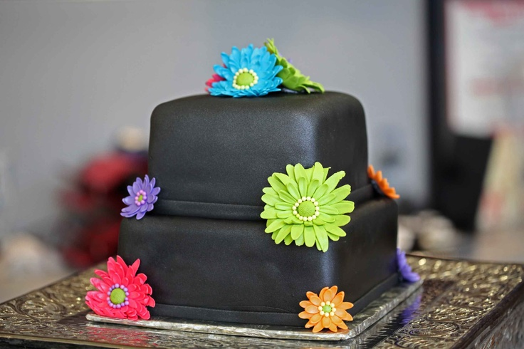 Black tie dye wedding cake.. interesting and cute.. maybe black & white?