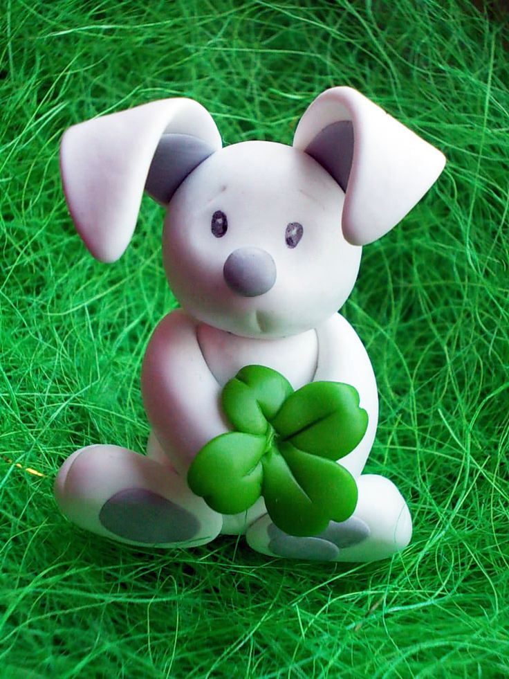 Polymer clay Easter bunny with clover  https://www.facebook.com/pages/Yippi/177229935734986