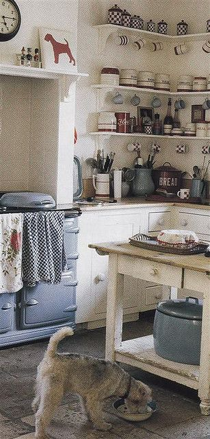 This reminds me of my grandma's kitchen. She always had poodles though. She had a brick wall behind the stove, black and white tile on the countertops with a wood butcher top on a tiny island. (photo is by Knitty, Vintage and Rosy)