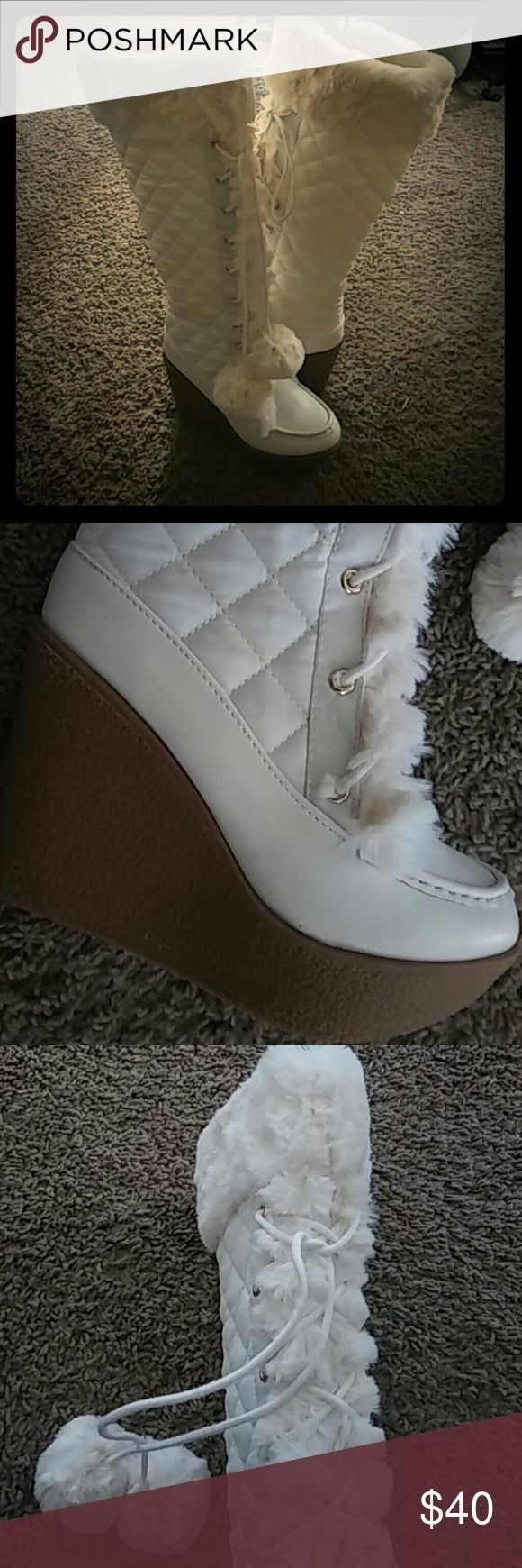 White furry winter wedge boots Quilted man made outter shell; lace in the front, with side zipper they do run small Shoes Winter & Rain Boots