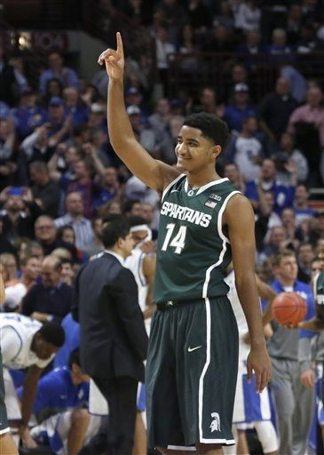 Gary Harris (14) celebrates the Spartans' 78-74 win over Kentucky in an NCAA college basketball game Tuesday, Nov. 12, 2013, in Chicago. (AP Photo/Charles Rex Arbogast)