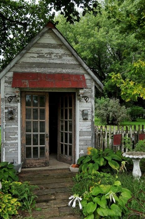 Amanas Colonies garden shed made from salvage - cute idea in using a faux facade for an entry into a separate garden :)