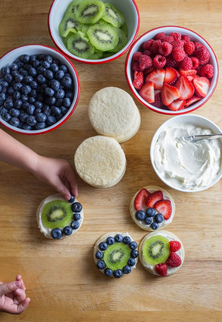 """As a competitive swimmer growing up, we used to have """"pasta parties"""" before big meets. (Do kids still do this? Or is carbo-loading not cool anymore?) Whenever we hosted the potluck-style shindig at our house, my mom and I would make fruit pizza for the grand finale. We pressed sugar cookie dough into a pizza pan and, after baking, topped it with cream cheese frosting and a rainbow of fresh fruit. These days, I like making mini versions for my son and his friends with a vanilla bean-..."""