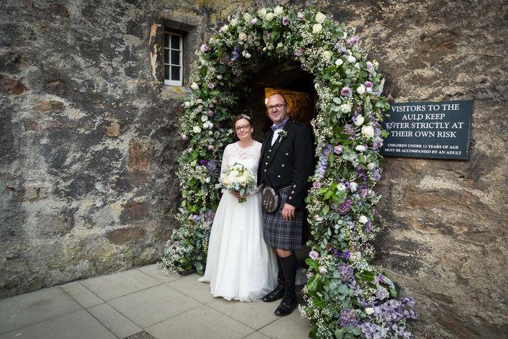 Planet Flowers - Dundas Castle Auld Keep Arch. First Light Photography. Ceremony Decoration. Scotland