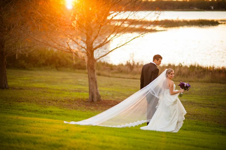 sunset over the lake for the bride and groom.