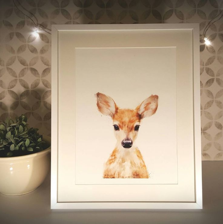 This gorgeous artwork is the picture of innocence, framed in white to highlight its simplicity. Wide-eyed is available at www.dalaur-creative.com