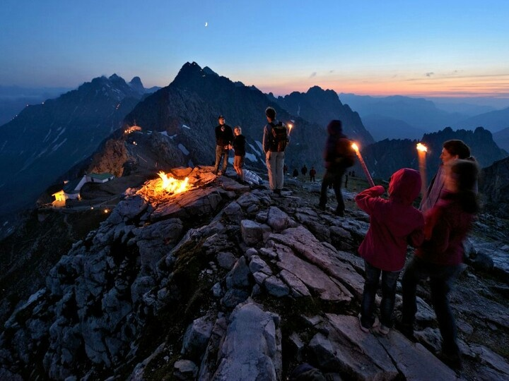 A group of mountaineers celebrates Sonnwendfeuer, or midsummer, atop Nordkette mountain near Innsbruck, Austria.