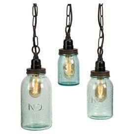 """Set of three mason jar-inspired pendants with vintage-style bulbs.  Product: Small, medium and large pendantConstruction Material: Glass and ironColor: Tinted greenAccommodates: (1) Vintage Edison bulb each - includedDimensions: Small: 5.25"""" H x 3.25"""" DiameterMedium: 7"""" H x 3.75"""" DiameterLarge: 8.75"""" H x 4.5"""" Diameter"""