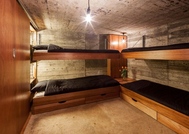 This concrete bunker is a World War Two relic that has been converted into a tiny holiday home by the Belgian firm, B-ILD. Set in Fort Vuren, The Netherlan