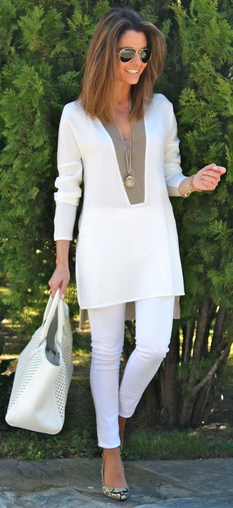 Try an all white outfit by pairing a tunic with tights or fitted pants. Perfect for a summer lunch meeting,