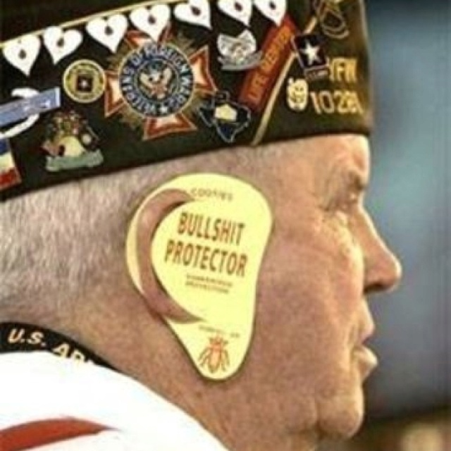 This man is wearing a protective flap over his ear while Joe Biden, Barack Obama, and Nancy Pelosi addressed the Veterans of Foreign Wars.