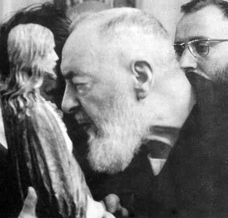 ST. PADRE PIO DAILY BLESSED MANY OBJECTS AND IMAGES WHICH WERE BROUGHT TO HIM FOR THAT PURPOSE. WE SEE HIM HERE KISSING A STATUE OF THE SACRED HEART. ST. PADRE PIO PRAYED THE NOVENA TO THE SACRED HEART OF JESUS EVERY DAY OF HIS LIFE.