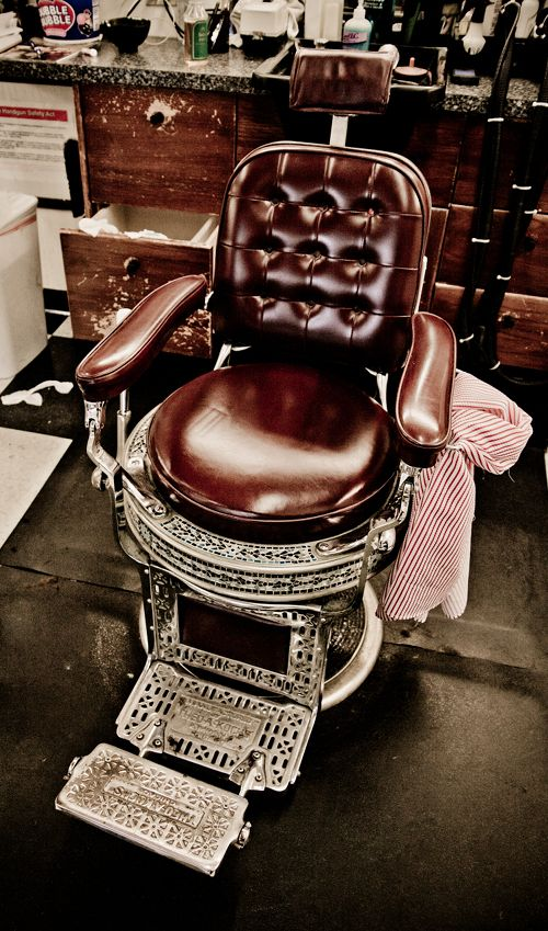 Hubby has always wanted a chair just like this....I have to say old barber chairs are awesome.