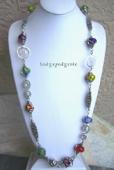 lecarnivale is unique sterling silver and lampwork necklace by jewelry artisan stacy perry her handcrafted
