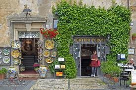 Orvieto, Italy. I remember this exact shop, with the ivy.