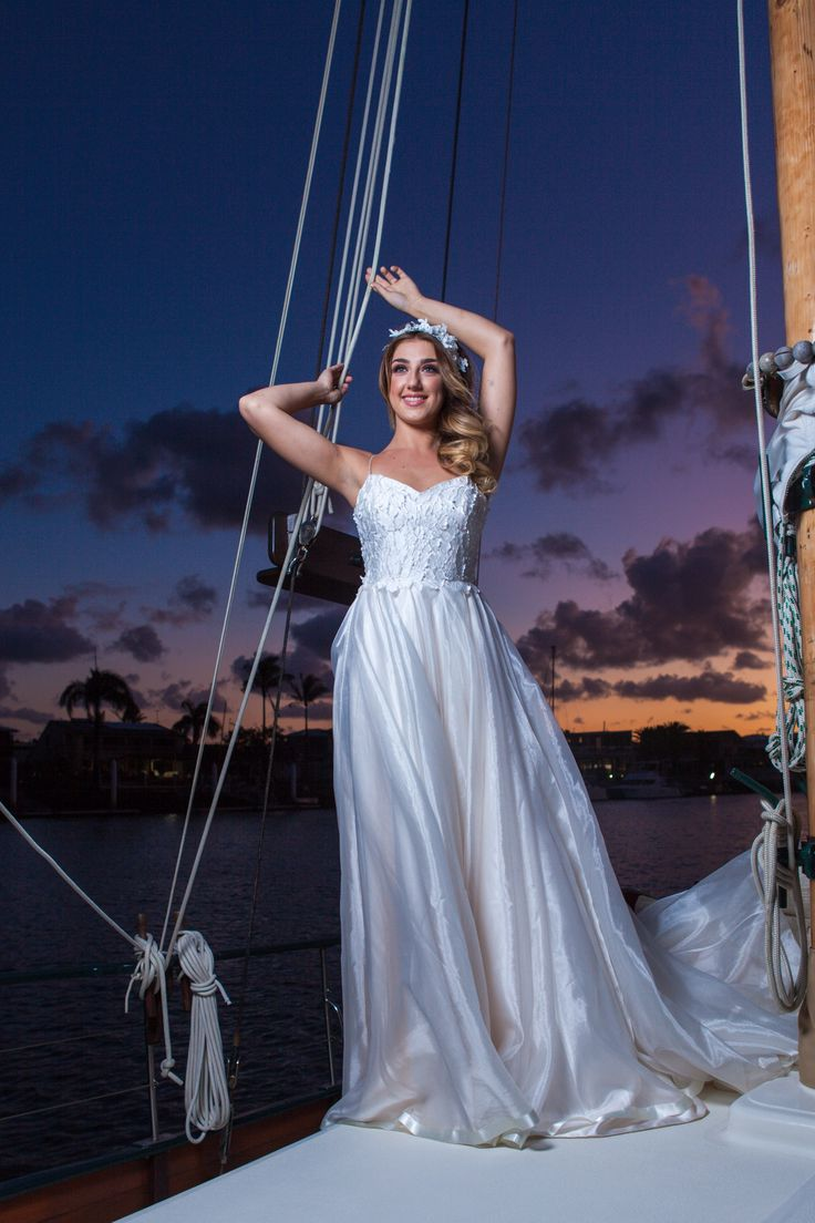 Stunning Styled shoot at Mooloolaba Yacht Club Photograhy by Benny Jewell Photography  Dress and Head Piece by Elizabeth De Vargo  Make up by Sally Townsend  Hair by Rolling Scissors
