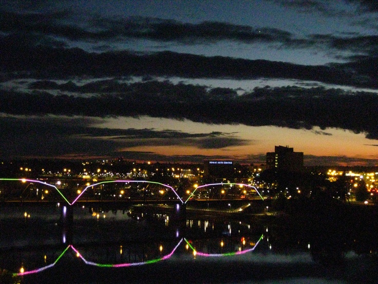 This is Saskatoon in the summer at dusk. Photo of Victoria Bridge from Rotary Park in summer