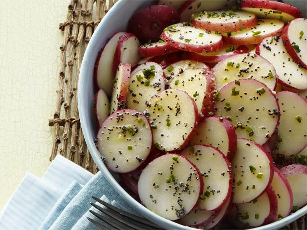 Try a mayo-free take on potato salad, prepared with a zippy dressing of Dijon mustard, vinegar and poppy seeds.