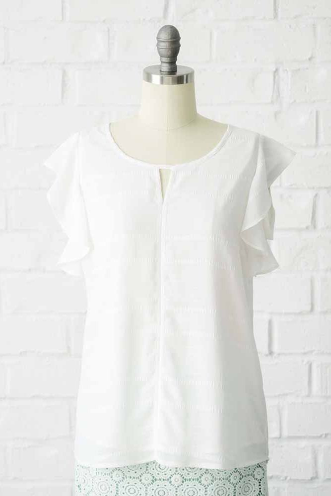 728c3ca81f244d Stay cool this summer with our white chiffon top. This modest top features ruffle  sleeves.Shell: 100% PolyesterLining: 100% PolyesterLength: 26