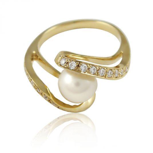 Кольцо из желтого золота с жемчужиной и цирконием Swarovski. Золото 585 пробы. Вес изделия - 3.70 грамма.