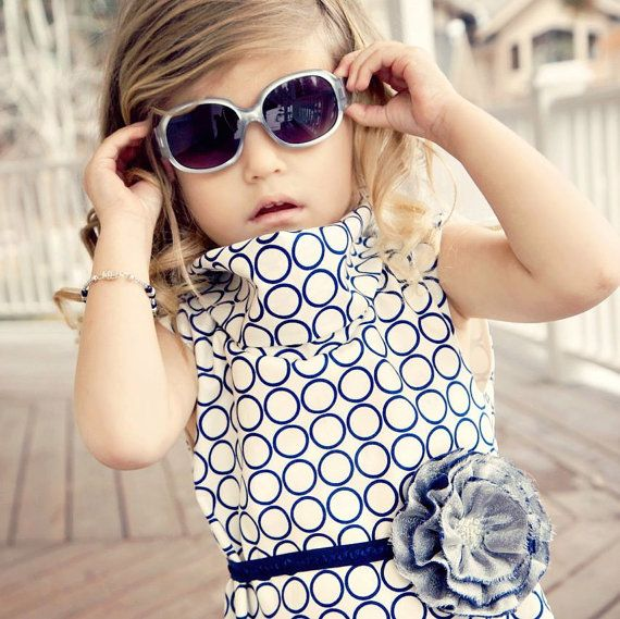 This etsy seller has the cutest dresses. Might have to break down and buy one of them!