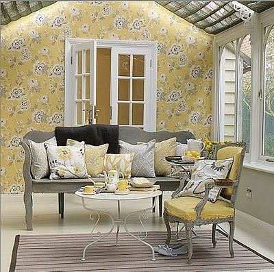 Pretty Use Of Yellow, White And Grey In This Bright Garden Room. Non  Upholstered Painted Bench Is Softened By A Mountain Of Cushions In Toning  Colours And ...