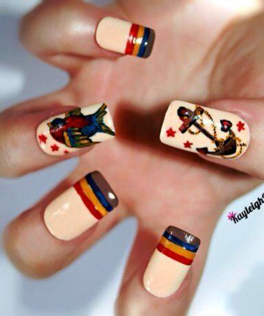 Cute anchors pinup style nail art design..