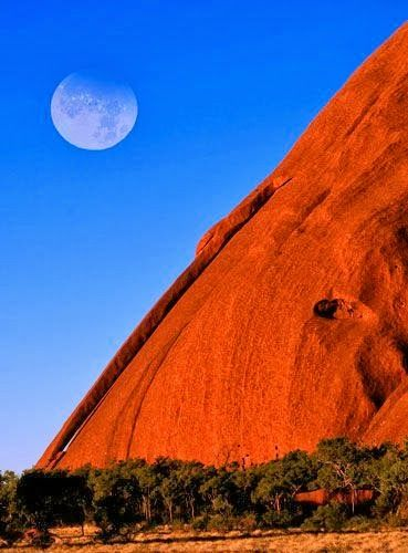 Uluru, Northern Territory, Australia - Uluru is one of Australia's most famous landmarks and is the country's most visited site. The mysterious red monolith is the weathered peak of a buried mountain range and rises some 430 meters from the desert and has a perimeter of about 5.5 miles.