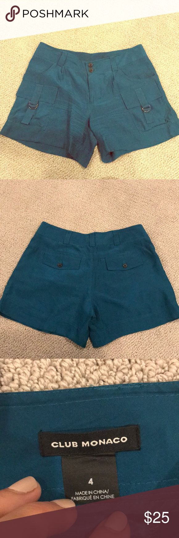 Club Monaco Silk Teal Shorts Club Monaco 100% Silk Teal Shorts with cargo pocket detail. Size 4. Only worn twice. Excellent condition. Great for summer or in the fall/winter with tights! Club Monaco Shorts
