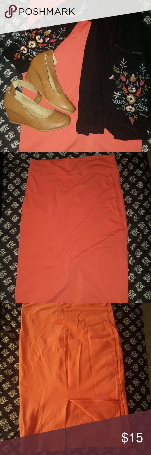 2X coral pencil skirt EUC Stunning 2x Coral pencil skirt with back slit. Thick waistband and stretchy material. Would make a great addition to any closet, bright fun fashionable color. Can be worn as a long knee length pencil skirt, or pulled up for a shorter look. Can also be worn as a tube top. Classy enough for the office but sexy enough for date night. Excellent used condition, like new.  * listing is for pencil skirt only, and does not include shoes necklace or sweater which were used…