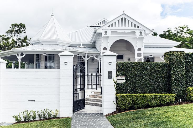 The neat clipped hedges balance out the decorative architectural elements of this imposing heritage property. See more of this [Classic Queenslander updated for family living](http://www.homestolove.com.au/classic-queenslander-updated-for-family-living-2577). Photo: Maree Homer / *Australian House & Garden*