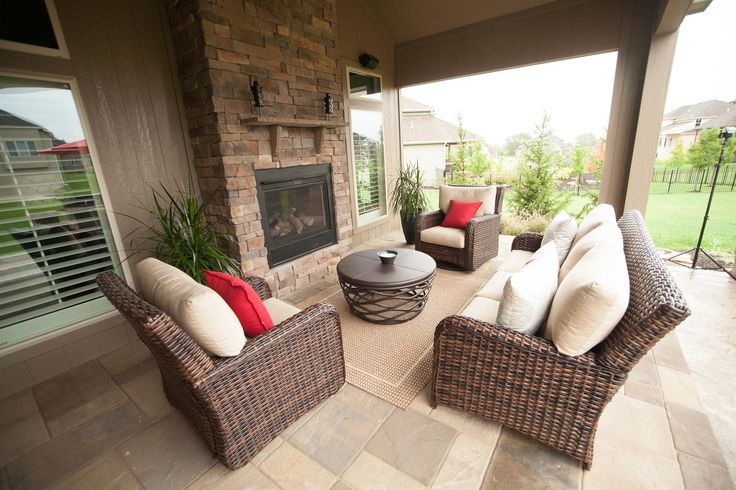 Outdoor living room with fireplace, paver patio, covered room.