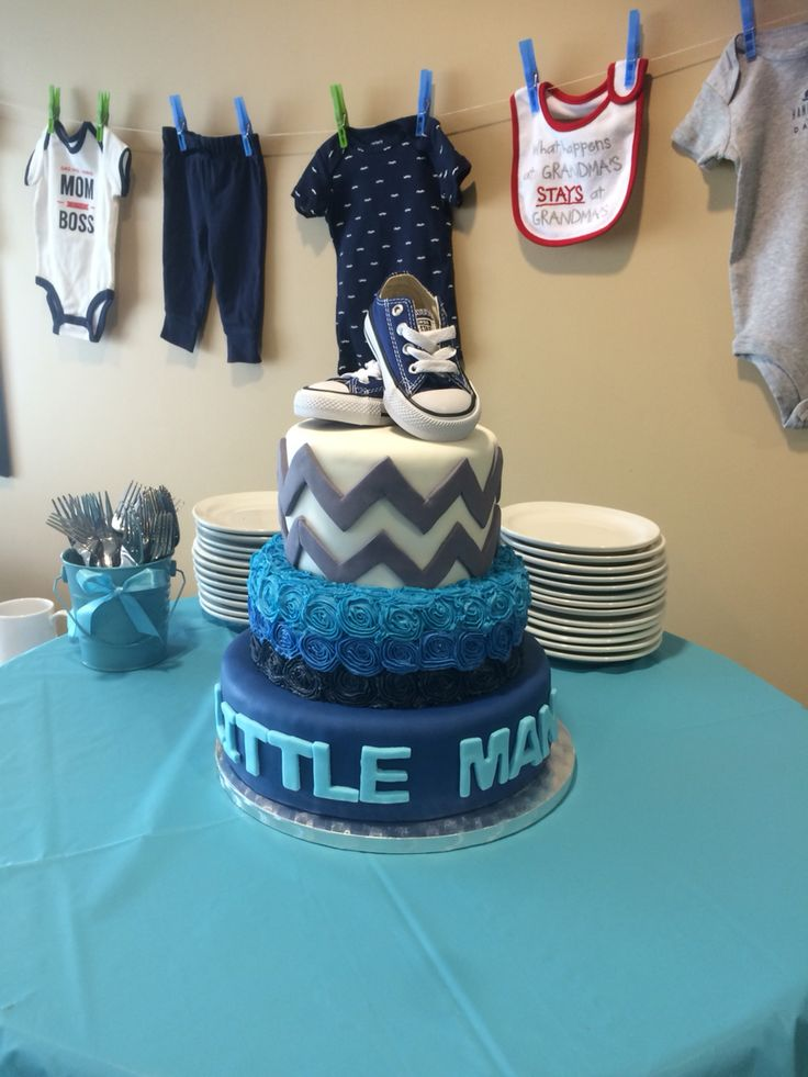 Little man / Grey Chevron theme cake with real converse baby shoes as a topper.