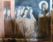 St Clare of Assisi and the Sisters of her order. St Clare was named the patron saint of Television in 1950's
