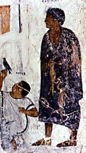 5. Roman Costume; This man is shown wearing a purple toga with gold embroidery which was also called a toga picta.