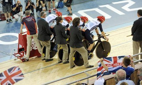 Great Britain's Ed Clancy, Geraint Thomas, Steven Burke and Peter Kennaugh prepare for the start in the first round of the Men's Team Pursuit at the Velodrome in the Olympic Park