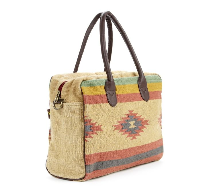 LOVE this travel bag. The Southwest print is great and would not show dirt! Perfect for a Summer of Fall vacation!