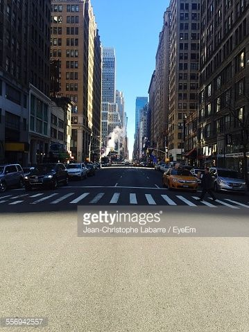 Stock Photo : Person Walking On Zebra Crossing Against Cars On City Street