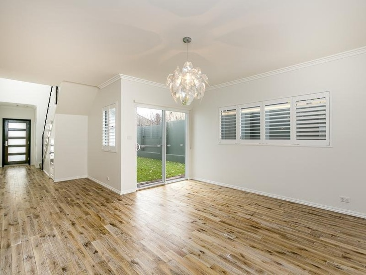Solid, limewashed oak flooring throughout the living areas.