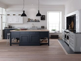 1909 Kitchens - Verulam Kitchens Beautiful balance of space and function.  Bright space for these floating white, and grounded dark furniture-styled cabinets. Nice.