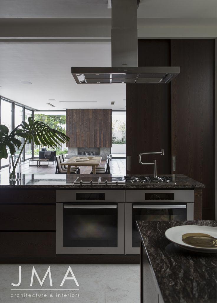 Dark kitchen interior featuring large sliding doors.