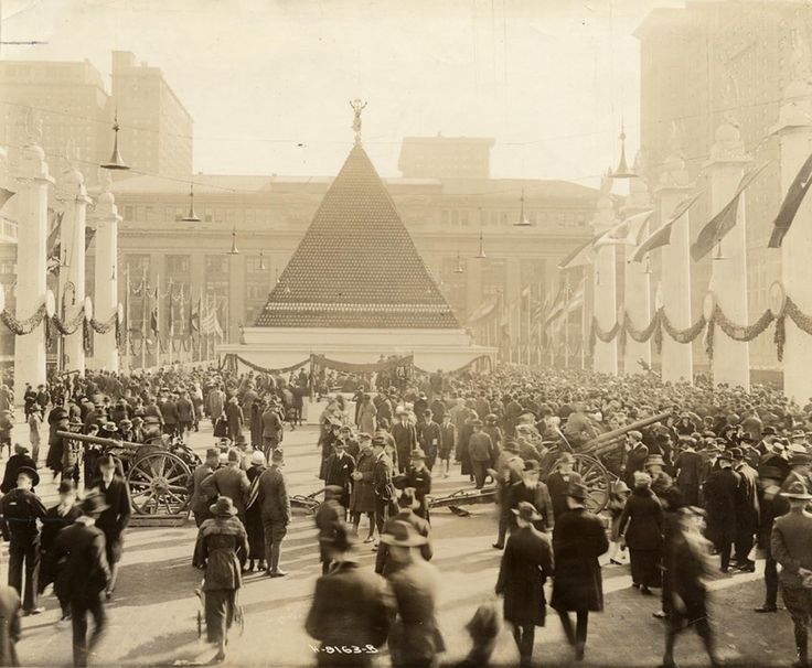 Pyramid of WWI captured German helmets at Grand Central, NYC, 1918. [1400 x 1153] : HistoryPorn