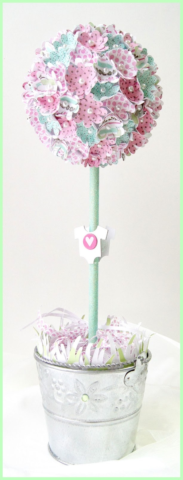 precious paper topiary...perfect centerpiece for a baby shower.