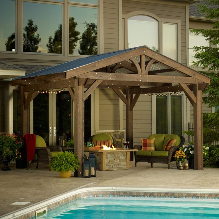 Beefy wooden pergola with corrugated metal roof