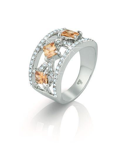 Кольцо  Гипоаллергенный ювелирный сплав. Фианиты огранки «багет» цвета «брызги шампанского», кристаллы Swarovski круглой огранки цвета «бриллиант». Ширина ободка кольца: 1,2 см в самой широкой части, 4 мм в самой узкой части.