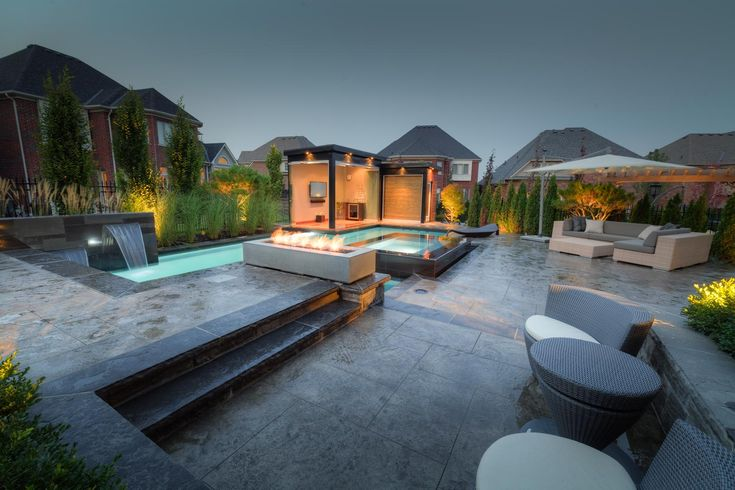 Long Rectangular Gas Fire Pit Set In Pool Desk Surrounded