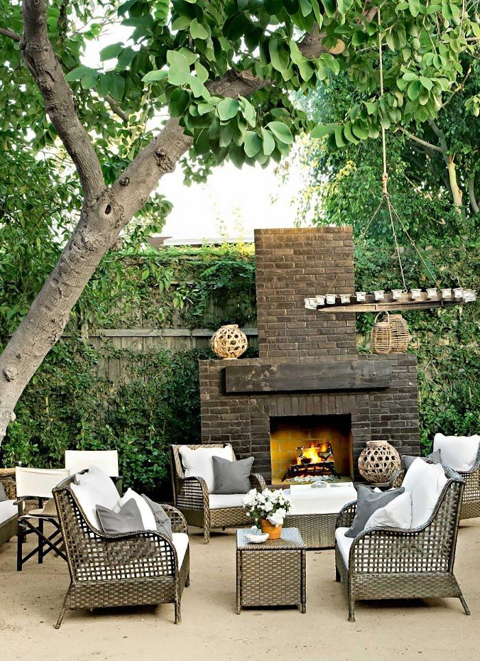 Green Living Wall and Fireplace - Comfy Outdoor Living