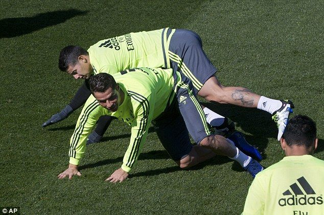 Portuguese winger Cristiano Ronaldo (centre) and fellow star James Rodriguez take a tumble during training